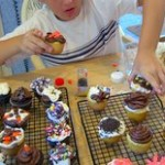 Kid making cupcakes