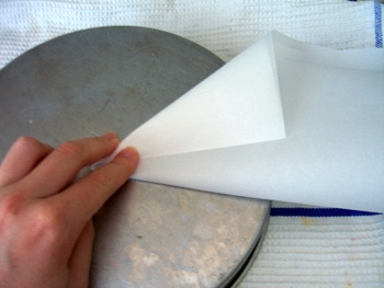 Lining a cake pan with parchment paper