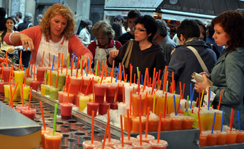 Buying smoothies at La Boqueria Market